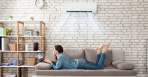 Woman Keeping Cool with a Ductless Air Conditioner