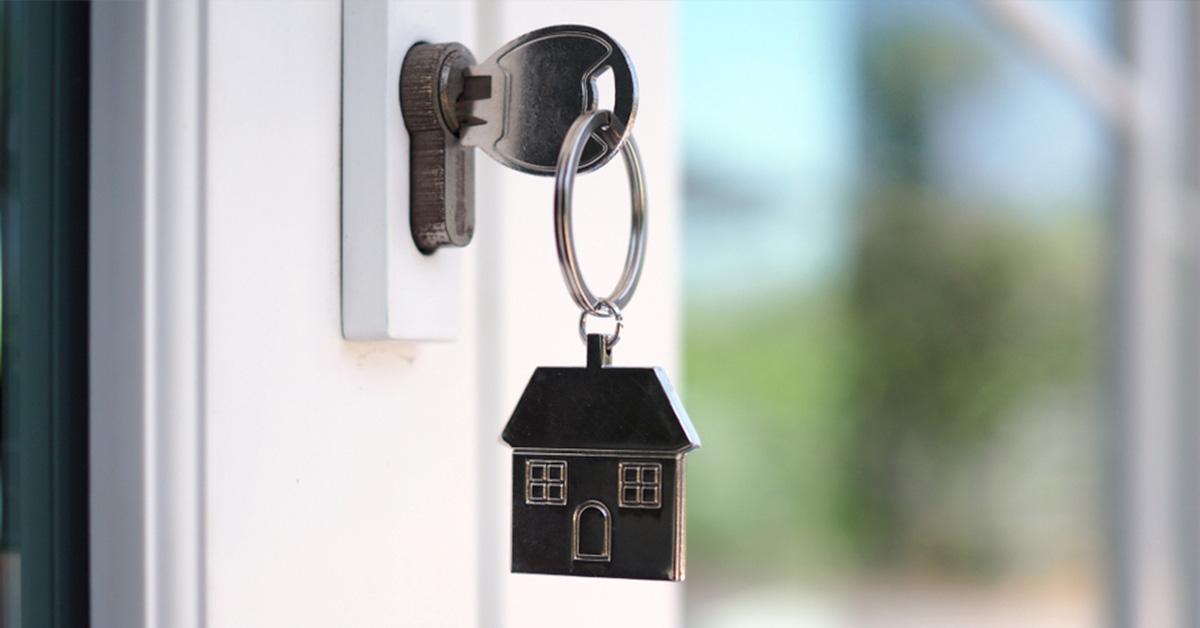 new homeowners key in unlocked front door